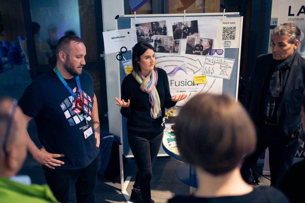 """Das Synergie-Projekt """"MindFusion"""" stellten unsere Kollegen Andrej von Bosch und Catharina von der MGO vor."""